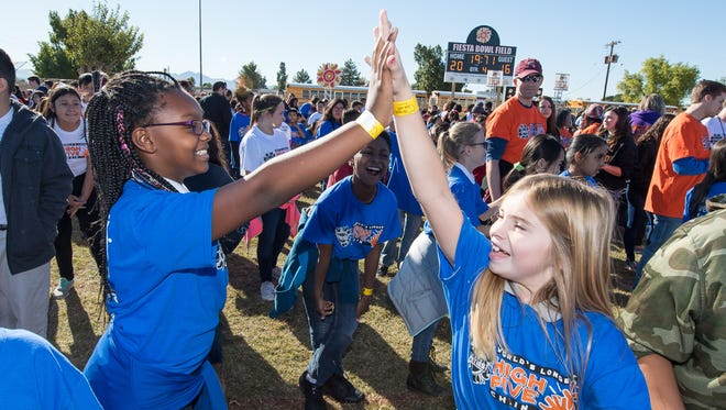 Nearly 3,500 kids in Avondale high-fived to break a world record on Nov. 30, 2016.