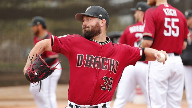 Arizona Diamondbacks starting pitcher Robbie Ray (38) throws during the first day of workouts for pitchers and catchers at Salt River Fields on the Salt River Pima-Maricopa Indian Reservation February 14, 2018.