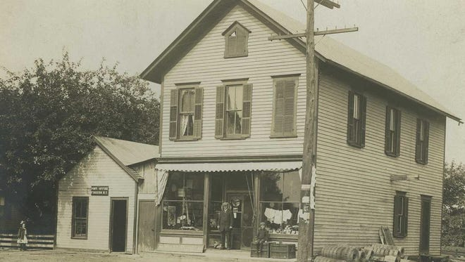 Store owner George P. Fowler, standing, and his son and future owner, Fred G. Fowler, pose for this circa 1910 photo.