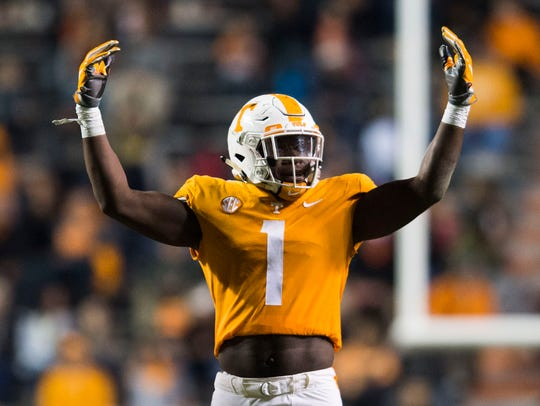 Tennessee defensive lineman Jonathan Kongbo (1) raises