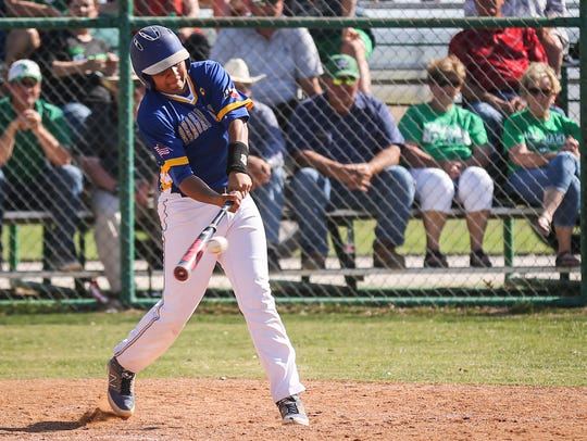 Reagan County's Justin Chavez hits the ball Monday,
