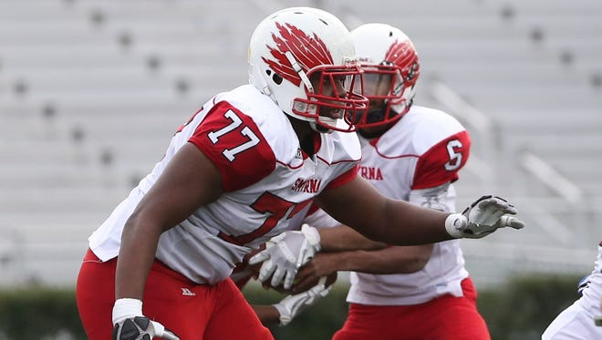 Smyrna's Saleem Wormley blocks on a run in the third quarter of Smyrna's 30-27 win in the DIAA Division I state title game at Delaware Stadium Saturday.