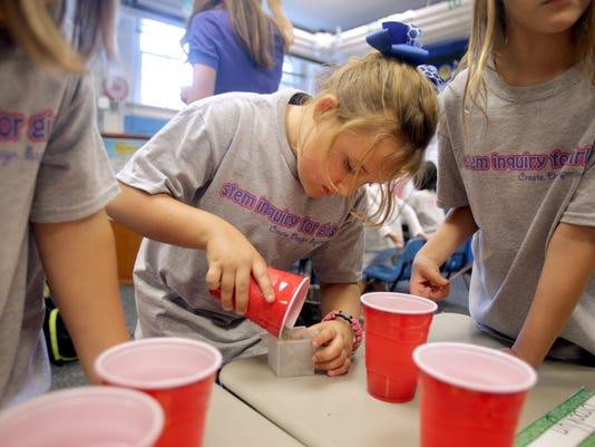 -2-Girls Science.jpg_20131001.jpg