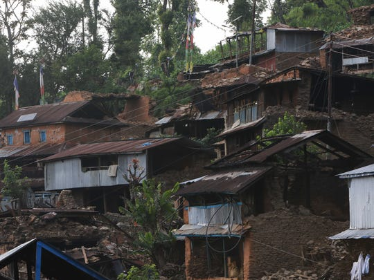 Houses in the Katunge village development community suffered extensive damage from a 7.8-magnitude earthquake that struck Nepal on April 25.