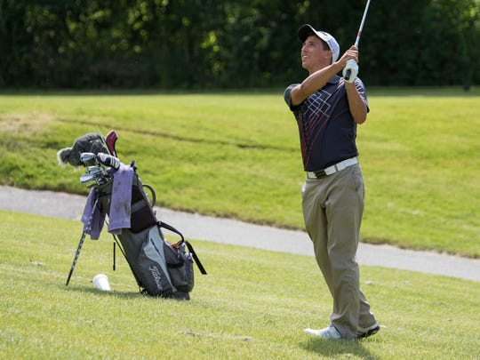 Matt Alderink follows his chip at Riverside Country Club on Wednesday.