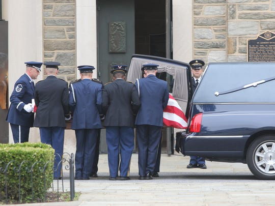 The coffin of former Delaware Attorney General Beau Biden is taken into St. Anthony of Padua Church in Wilmington on Friday. A funeral Mass was to be held Saturday at St. Anthony, with President Barack Obama delivering a eulogy.