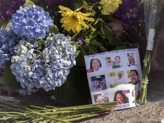 Flowers and notes of hope and support from the community line the sidewalk June 19, 2015, in front of the Emanuel A.M.E. Church in Charleston, S.C.