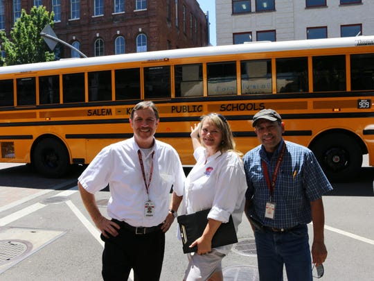 From left, Brian Clarke, Lisa Puentes and David Sol, driver trainers for the Salem-Keizer School District Transportation Services, brought a 2015 school bus to Holding Court on Tuesday. It is one of 80 new vehicles delivered this summer.