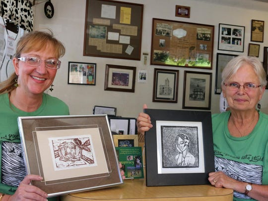 Jennifer Kent, left, and Joyce Parmeter show off some of the works created by students of the Summer Arts Program, which serves nearly 100 students in the communities of Amity, Ballston, Sheridan, Willamina and Grand Ronde.