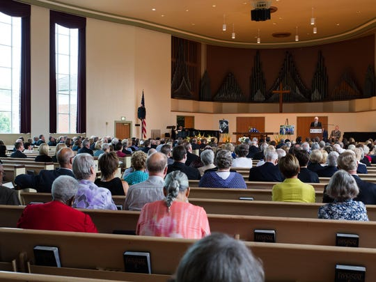 People fill the Goodrich Chapel in Albion Saturday afternoon for the funeral of Judge James Kingsley.