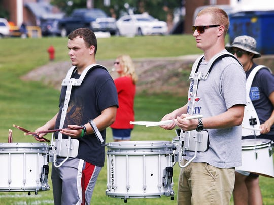 The Olivet College marching band drummers keep the beat during Tuesday's practice.