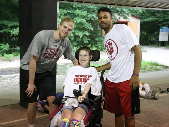 Tim Priller and James Blackmon Jr. visit campers at