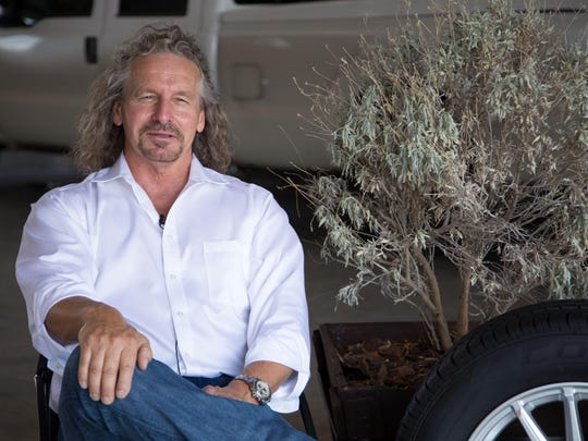 PanAridus CEO Mike Fraley next to a guayule plant and a tire made by Cooper Tire and Rubber Co. Some of the tire's parts come from PanAridus guayule rubber, based in Arizona.