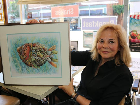 """Debby Denno displays her steampunk creation, """"Finding Nemo,"""" a play on both the Jules Verne's """"Twenty Thousand Leagues under the Sea"""" and Disney Pixar's popular clownfish movie."""