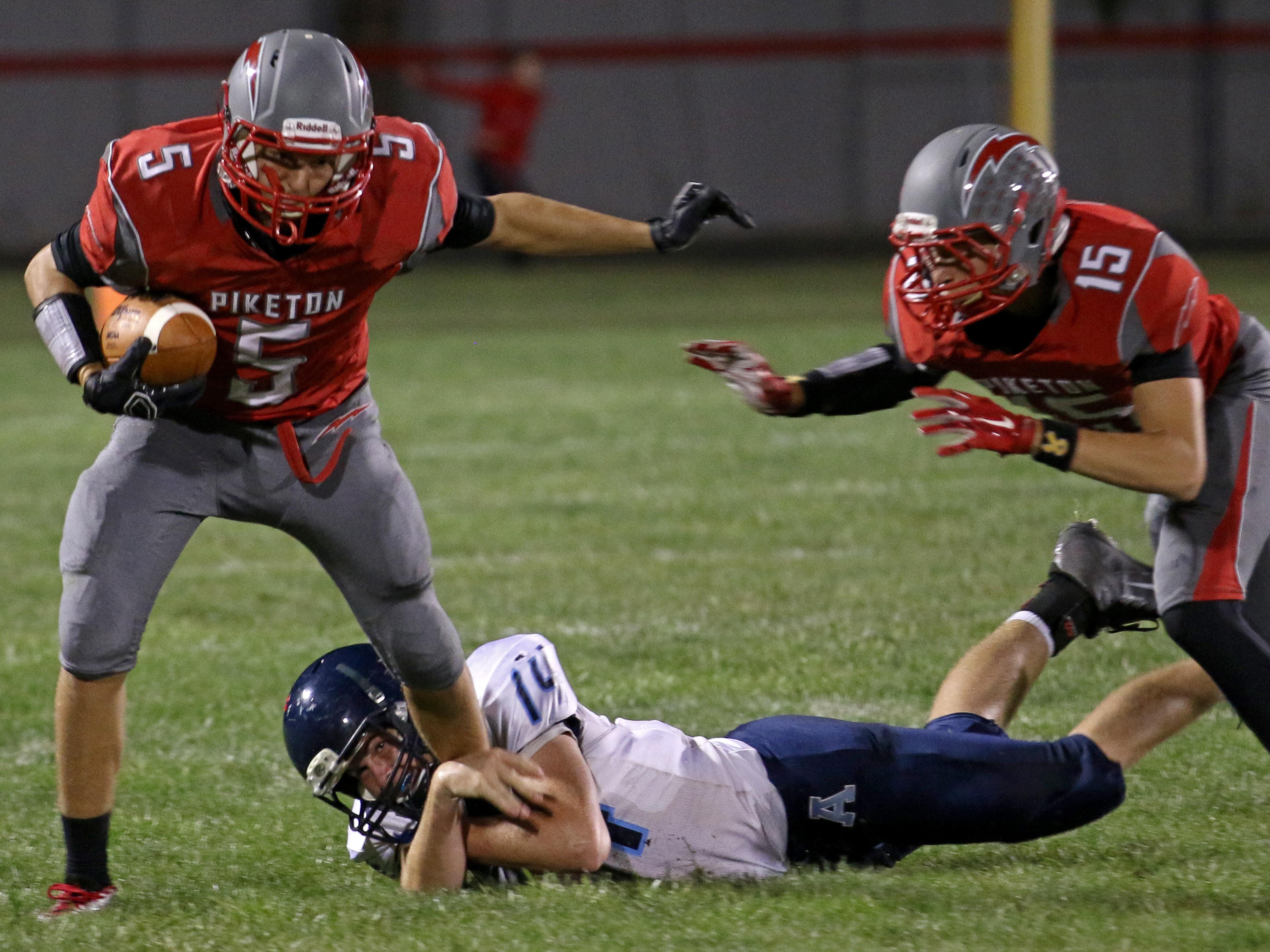 Piketon's Gabe Birkhimer tries to break Adena's Jake Dawson's attempt at a tackle during Friday's game at Piketon. The final score was Adena 47, Piketon 12.