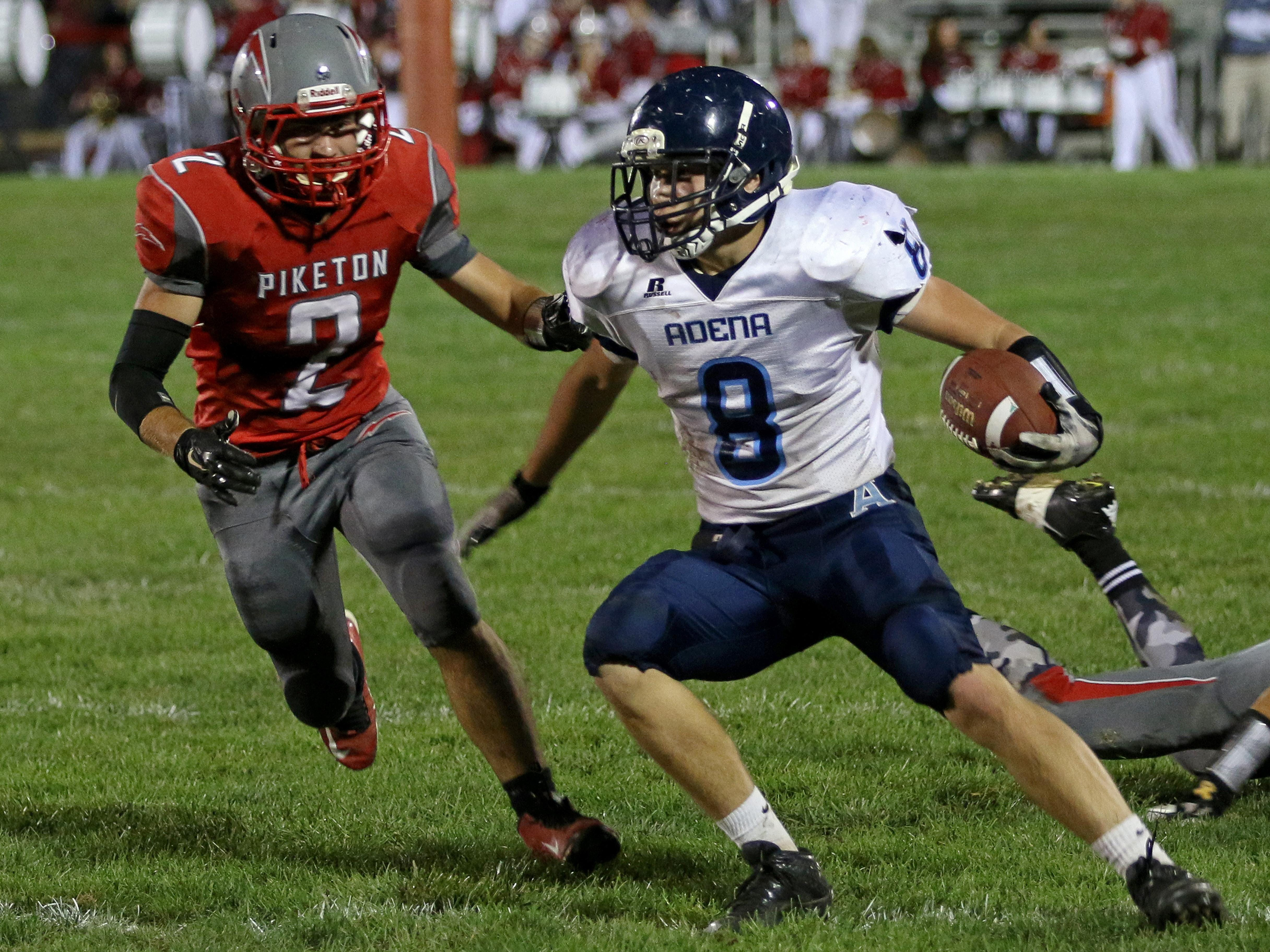 Adena's Isaac Thomas tries to outmaneuver Piketon's Brad Sickles as he runs the ball down field during Friday's game at Piketon. The final score was Adena 47, Piketon 12.