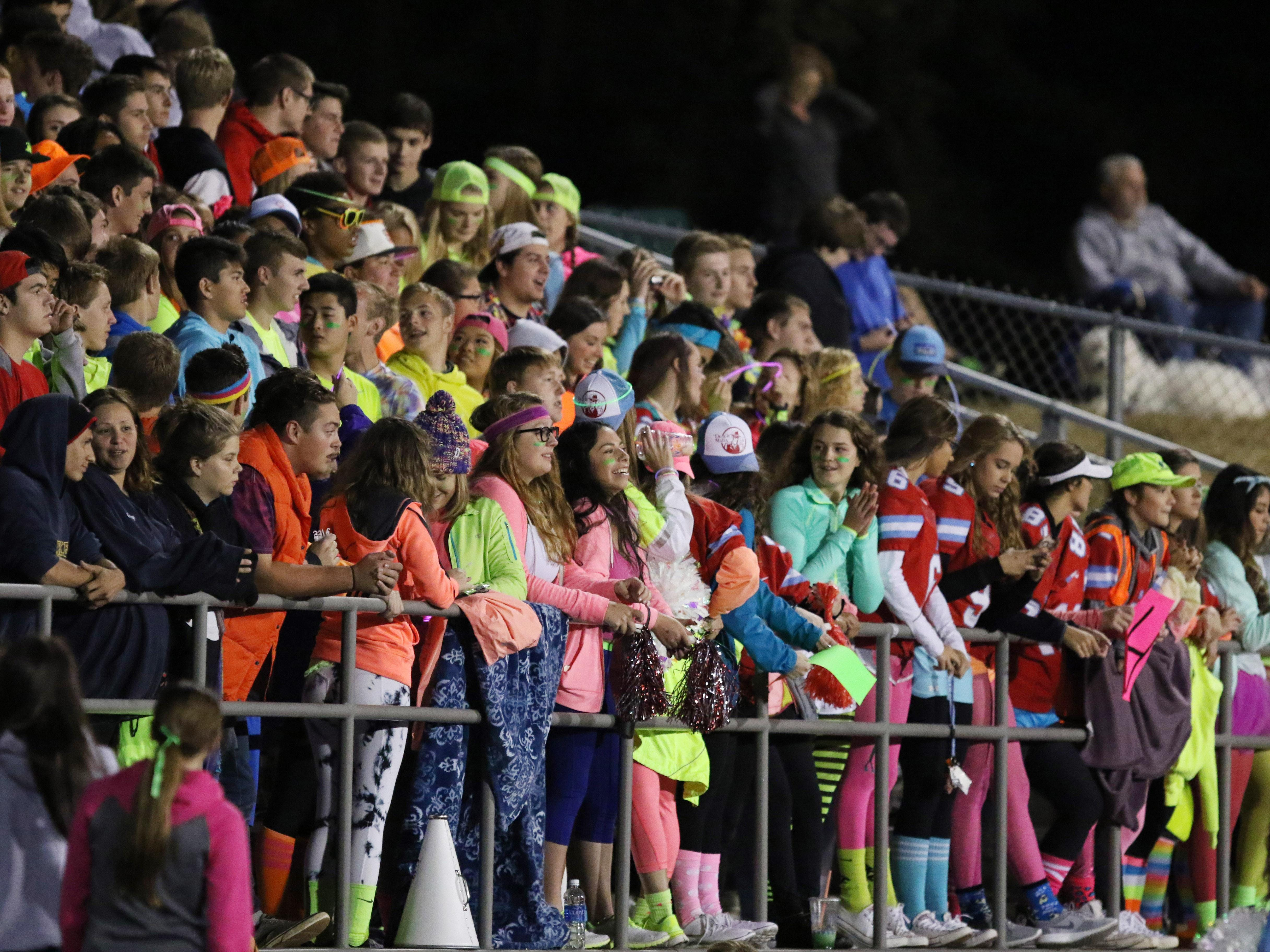 South Salem fans cheer as the Saxons defeat West Salem 50-43 in overtime during a game on Friday, Sept. 25, 2015, in Salem.
