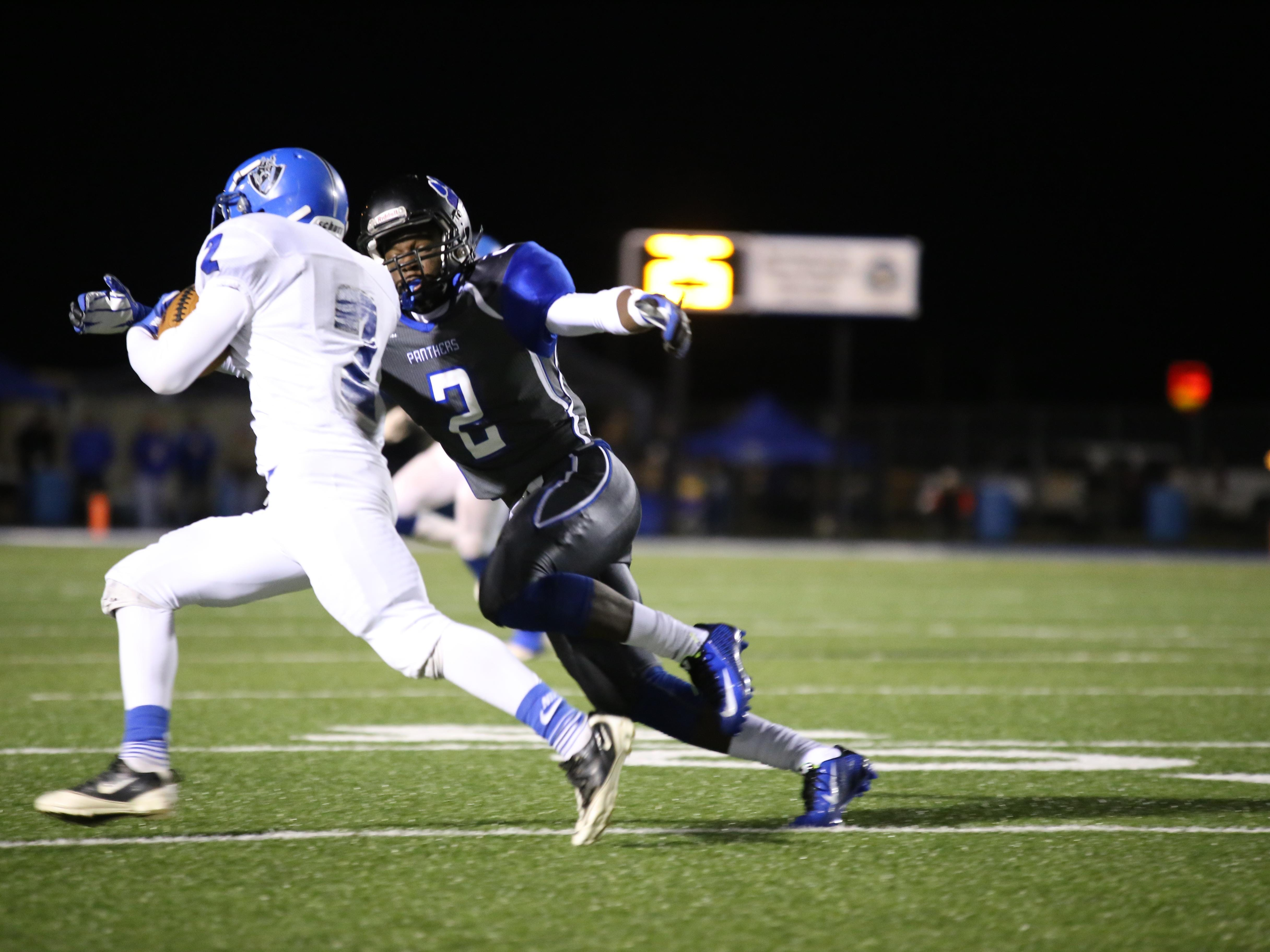 Ruby Chang/The News-Star Sterlington?s CJ Colvin (2) tackles Tyriq Kelly of Northeast during Friday?s game.