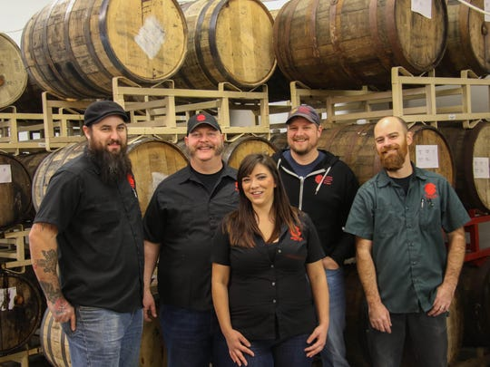 From left: Portland sales rep Michael Carter, co-owner and sales manager Matt Killikelly, sales rep Cassie Eckman-Harris, co-owner and treasurer Jim Smiley and co-owner and head brewer Jerome Goodrow are photographed in the barrel room at Santiam Brewing on Dec. 2, 2015