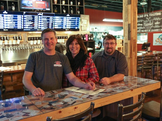 From left: Monte Baker, Jodi Baker and Michael Sublett are three of the four owners of Sparky's Brewing. Photographed Dec. 11, 2015.