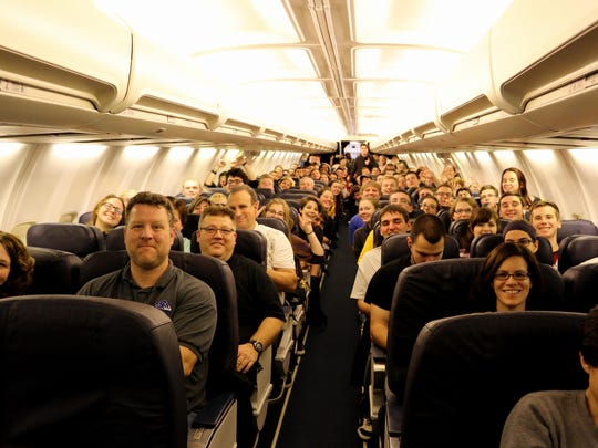 The Plymouth-Canton Marching Band readies for a take-off to California Sunday.