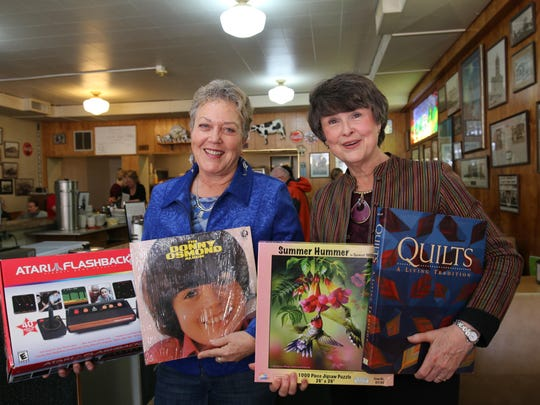 From left, Joyce Zook and Penny Blackwell showcase some of the items that will be on sale for the First Christian Church's annual book sale.