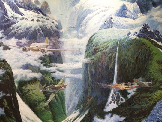 """Detail of the painting """"Flying the Hump,"""" on display in the Chennault Room at the Chennault Aviation and Military Museum in Monroe. Pilots flying from India to China flew over the Himalayas, which they called """"The Hump."""" The painting is part of an interactive exhibit that includes a video of newsreel footage explaining the dangers of flying over the Himalayas."""