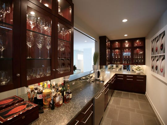 Next to the kitchen is a butler's pantry. A pass-through makes it a good place for serving at parties.