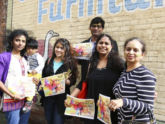 Members of the INDUS Salem came to Holding Court to invite the community to Holi, a festival of color, on March 12 at Columbia Hall at the state fairgrounds. From INDUS, from left are Jannet Prabha, holding her son, 2-year-old Ryan Sachin, Priya Palkolanu, Sridevi Talluri, and Anita Khanna. Surya Duggirala is in the back row.