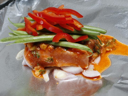 Baking fish in a foil packet keeps it moist and makes