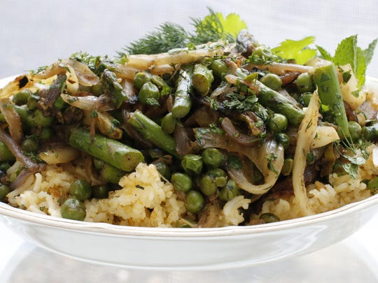 To make a perfect spring dish, this pilaf combines basmati rice with snap-crisp asparagus and spiced fennel, onions and garlic cooked slowly until soft.