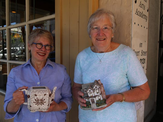 Georgia Wilks and Barbara Lacey hold items destined for the three-day rummage sale at St. Paul's Episcopal Church.