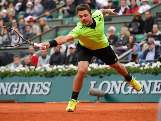 Switzerland's Stan Wawrinka misses a return in the fourth round match of the French Open tennis tournament against Serbia Viktor Troicki at the Roland Garros stadium in Paris, France, Sunday, May 29, 2016. (AP Photo/Christophe Ena)