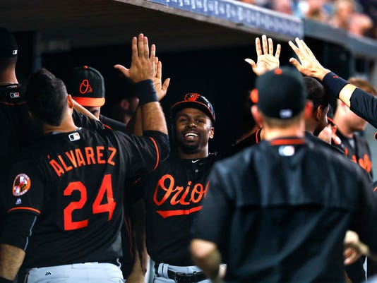 Baltimore Orioles' Michael Bourn celebrates after scoring on an Adam Jones single against the Detroit Tigers during the eighth inning of a baseball game in Detroit, Friday, Sept. 9, 2016. (AP Photo/Paul Sancya)