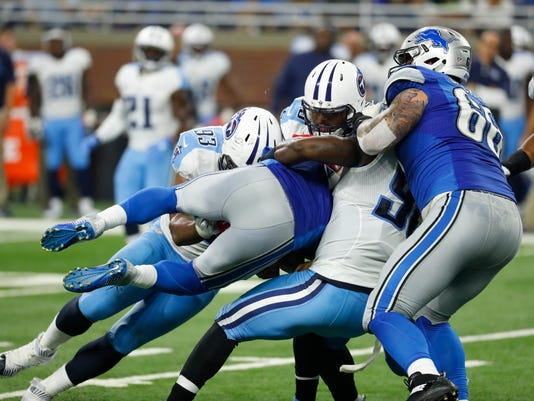 Detroit Lions quarterback Matthew Stafford is sacked by the Tennessee Titans defense during the second half of an NFL football game, Sunday, Sept. 18, 2016, in Detroit. (AP Photo/Paul Sancya)