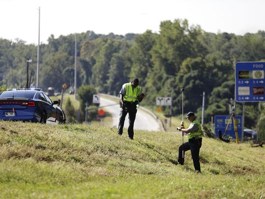 Georgia state troopers collect evidence along a highway exit ramp at the scene of an accident that killed rapper Shawty Lo in Atlanta on Wednesday. Fulton County police Cpl. Maureen Smith said the car struck a couple of trees and burst into flames before dawn Wednesday on Interstate 285 near the exit to Cascade Road.
