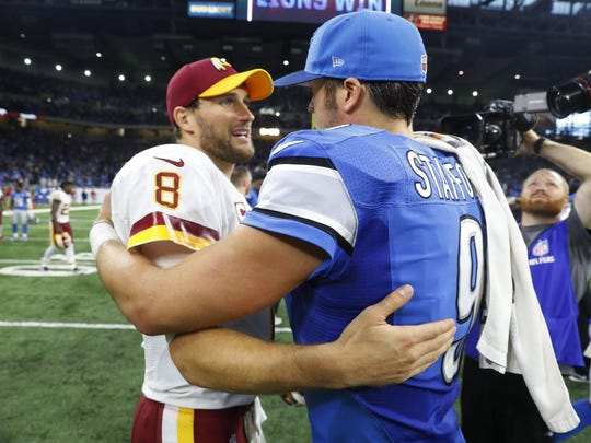 Washington Redskins quarterback Kirk Cousins (No. 8) and Detroit Lions quarterback Matthew Stafford (No. 9) greet each other at midfield. Those in the crowd cheering Cousins were family, friends and many well-wishers from his Holland high school and Michigan State days.