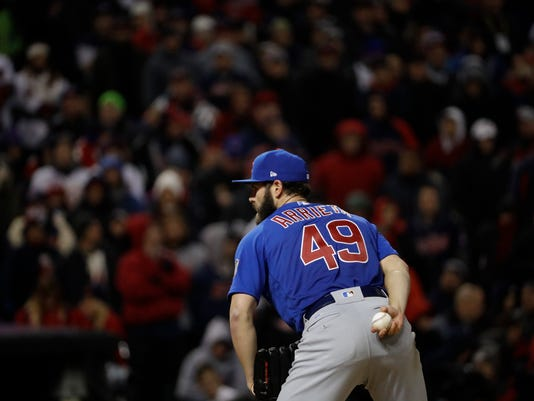 Chicago Cubs starting pitcher Jake Arrieta throws during the sixth inning of Game 2 of the Major League Baseball World Series against the Cleveland Indians Wednesday, Oct. 26, 2016, in Cleveland. (AP Photo/David J. Phillip)