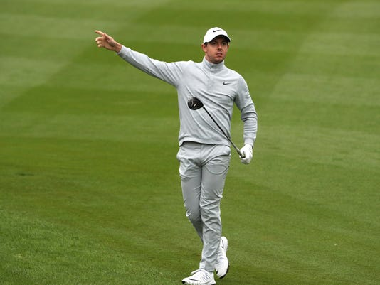 Rory McIlroy of Northern Ireland gestures as he watch his shot from the fairway during the 2016 WGC-HSBC Champions golf tournament at the Sheshan International Golf Club in Shanghai, China, Saturday, Oct. 29, 2016. (AP Photo/Ng Han Guan)