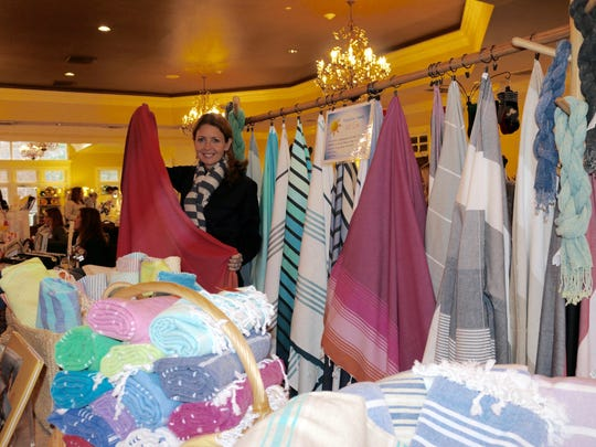 Sima Asa, proprietor of Atolya, a favorite vendor at the 2015 Holiday Boutique, will be returning to display her offering of luxurious Turkish towels at this year's event, which helps the Town Club provide grants totalling $24,000 to scores of local education, service and charity organizations.