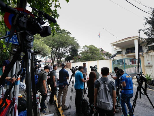 Journalists gather outside North Korean embassy in Kuala Lumpur, Malaysia, Friday, Feb. 24, 2017. The banned chemical weapon VX nerve agent was used in the murder of Kim Jong Nam, the North Korean ruler's outcast half brother who was poisoned last week at the airport in Kuala Lumpur, police said Friday. (AP Photo/Vincent Thian)
