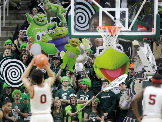Michigan State fans try to distract Nebraska guard Tai Webster (0) on a free throw during the second half of an NCAA college basketball game, Thursday, Feb. 23, 2017, in East Lansing, Mich. (AP Photo/Carlos Osorio)