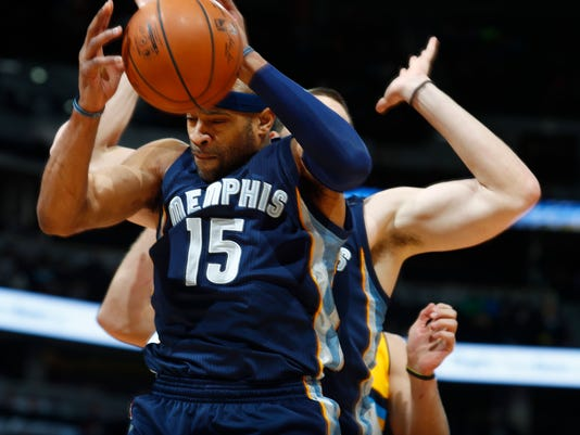 Memphis Grizzlies guard Vince Carter, front, pulls in a rebound in front of center Marc Gasol, of Spain, while facing the Denver Nuggets late in the second half of an NBA basketball game Sunday, Feb. 26, 2017, in Denver. (AP Photo/David Zalubowski)