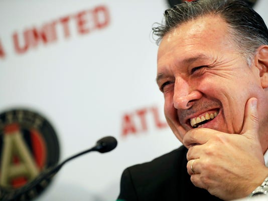 """FILE - In this Sept. 28, 2016, file photo, Gerardo """"Tata"""" Martino speaks during a news conference in Atlanta, introducing him as the new head coach for the Atlanta United MLS expansion soccer team. The theme for Major League Soccer this season is 22 for 22, as the league embarks on its 22nd year with 22 teams, including two new teams in Atlanta and Minnesota.   (AP Photo/David Goldman, File)"""