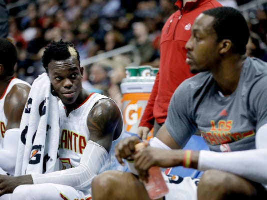 Atlanta Hawks' Dennis Schroeder, left, of Germany, and Dwight Howard sit on the bench during the second quarter of the team's NBA basketball game against the Brooklyn Nets in Atlanta, Wednesday, March 8, 2017. Atlanta won 110-105. (AP Photo/David Goldman)
