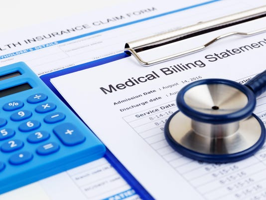 Medical bill and insurance form with calculator