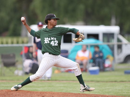 Regis's JaVon Logan pitches as the Rams fall to Kennedy 8-7 on Wednesday, May 18, 2016, in Mt. Angel.