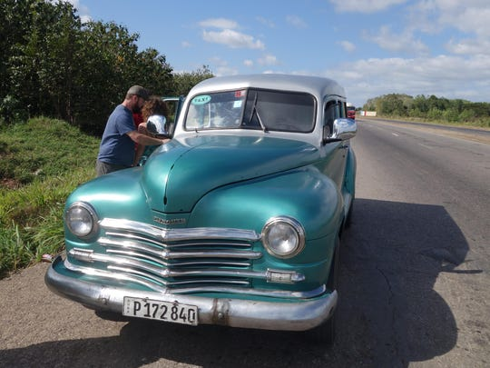 """This 1948 Plymouth is used as a """"collectivo taxi."""" The author and eight others made the three-hour journey from Vinales to Havana in the vehicle."""