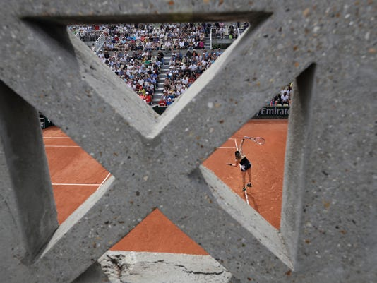 Canada's Eugenie Bouchard serves against Japan's Risa Ozaki during their first round match of the French Open tennis tournament at the Roland Garros stadium, in Paris, France. Tuesday, May 30, 2017. (AP Photo/Petr David Josek)