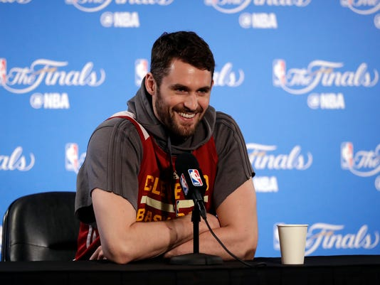 Cleveland Cavaliers' Kevin Love smiles as he fields questions before an NBA basketball practice, Wednesday, May 31, 2017, in Oakland, Calif. The Cavaliers face the Golden State Warriors in Game 1 of the NBA Finals on Thursday in Oakland. (AP Photo/Marcio Jose Sanchez)